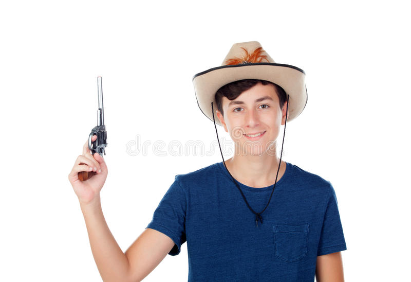 有牛仔帽和枪的少年男孩 库存照片