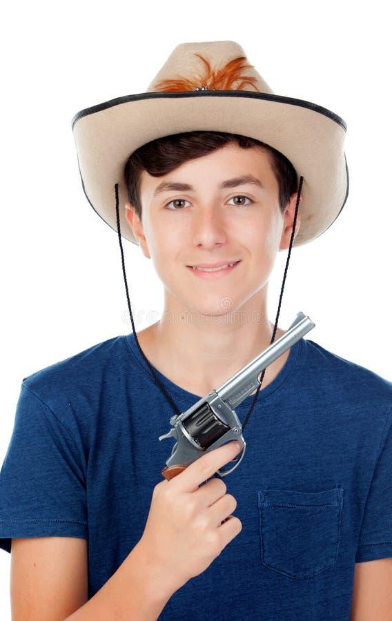 有牛仔帽和枪的少年男孩 免版税库存照片