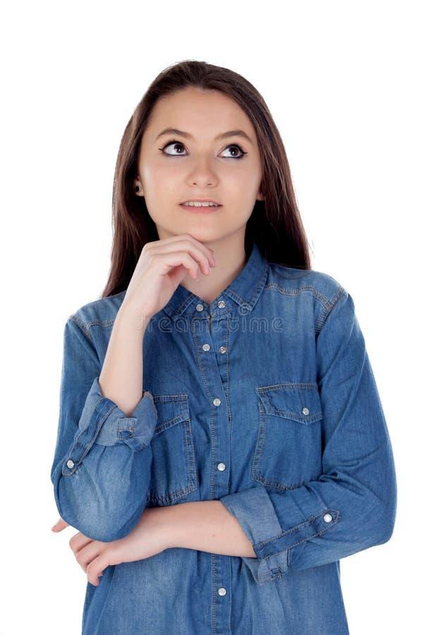 有牛仔衬衣的可爱的少妇 免版税库存图片