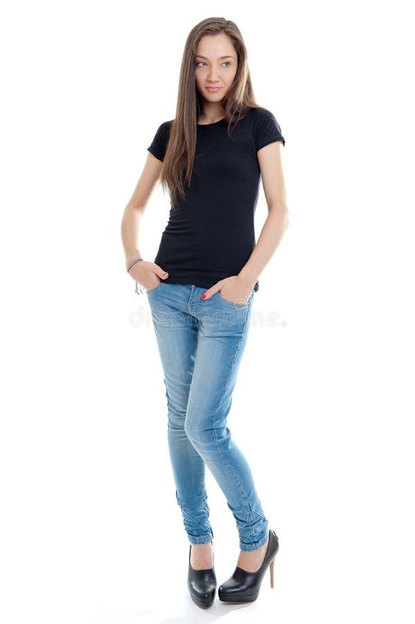 有牛仔裤和高跟鞋的常设少妇 库存图片