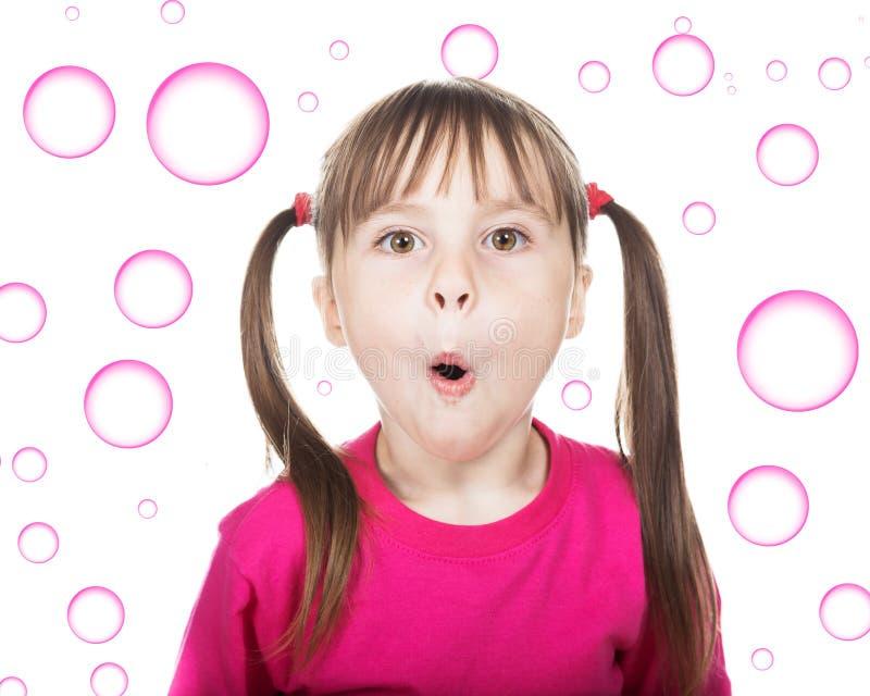 有猪尾的愉快的小女孩 免版税图库摄影