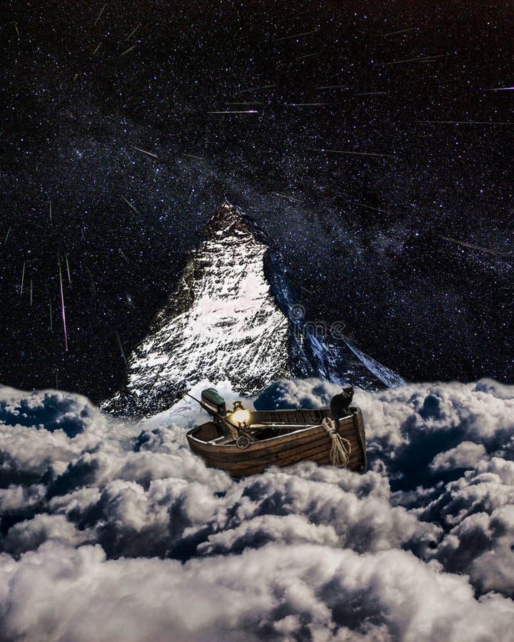 有猫的云彩小船 图库摄影