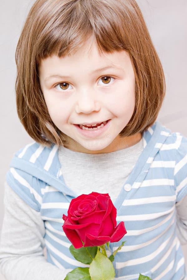 有玫瑰的女孩 图库摄影