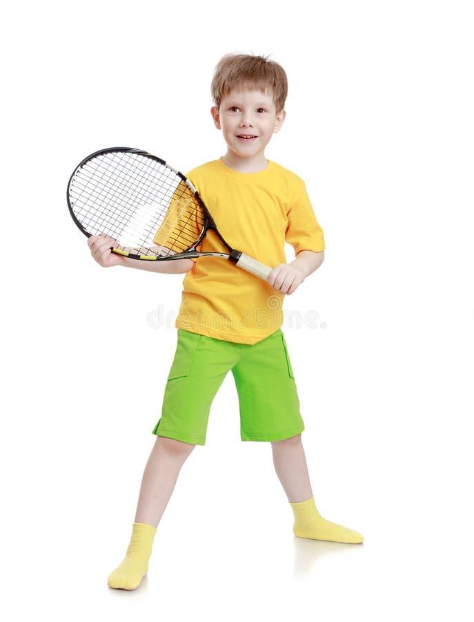 有球拍的男孩在手中 免版税库存照片