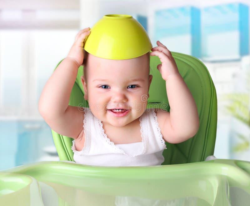 有瓶的婴孩在白色背景 免版税库存照片