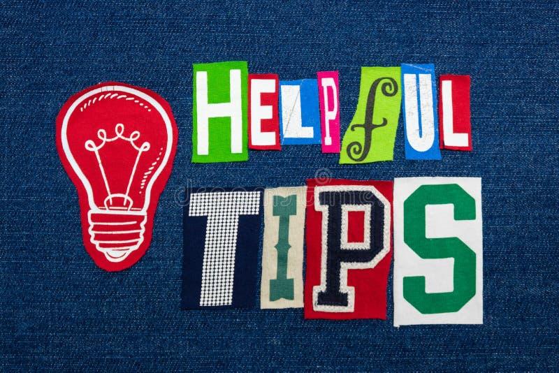 有用的技巧发短信给在五颜六色的织品的词拼贴画在蓝色牛仔布,可控诉的解答 免版税库存照片