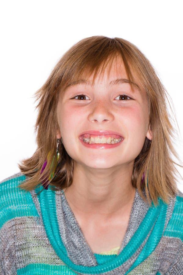 有用羽毛装饰的头发的愉快的女孩 库存图片