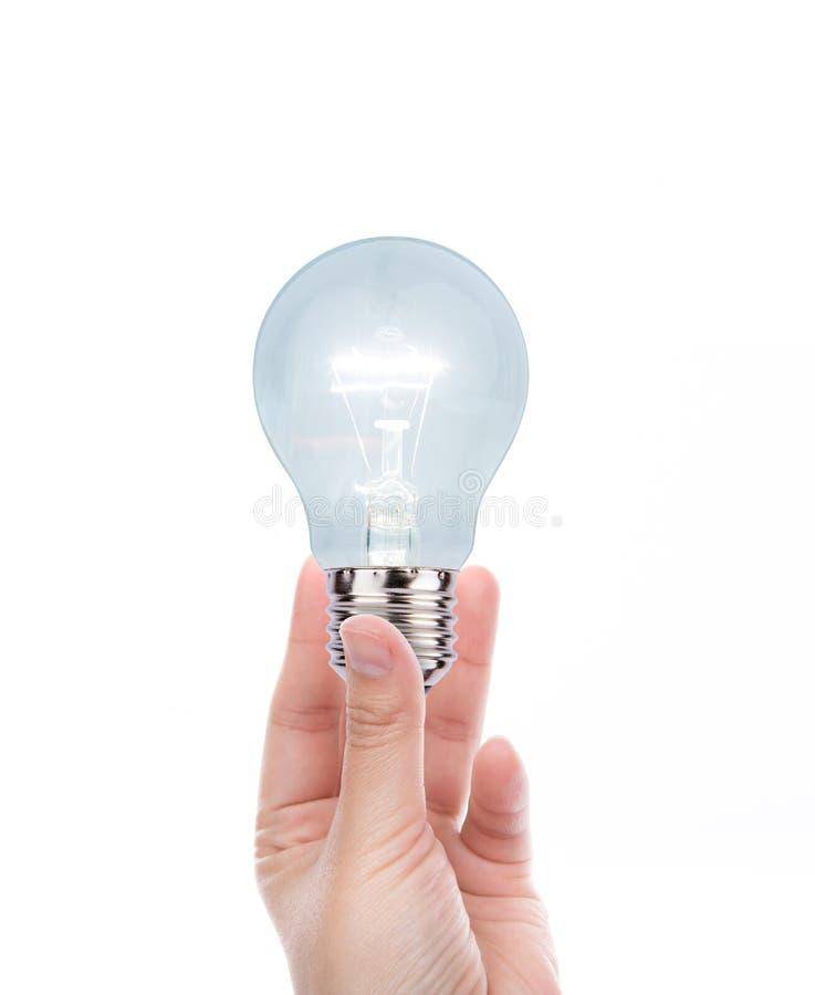 有电灯泡的手 库存照片