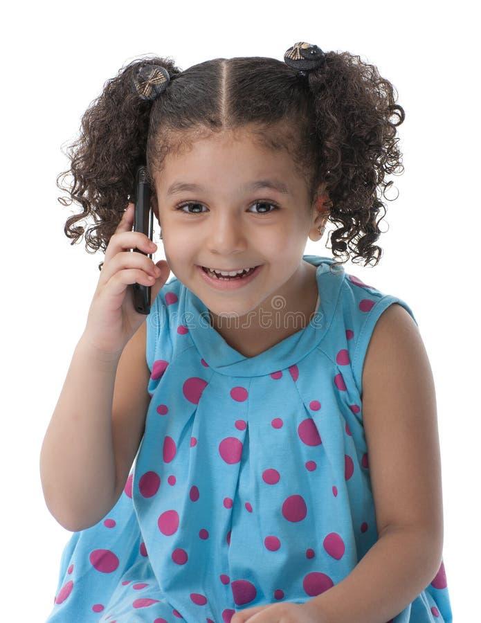 有电话的小女孩 免版税库存图片