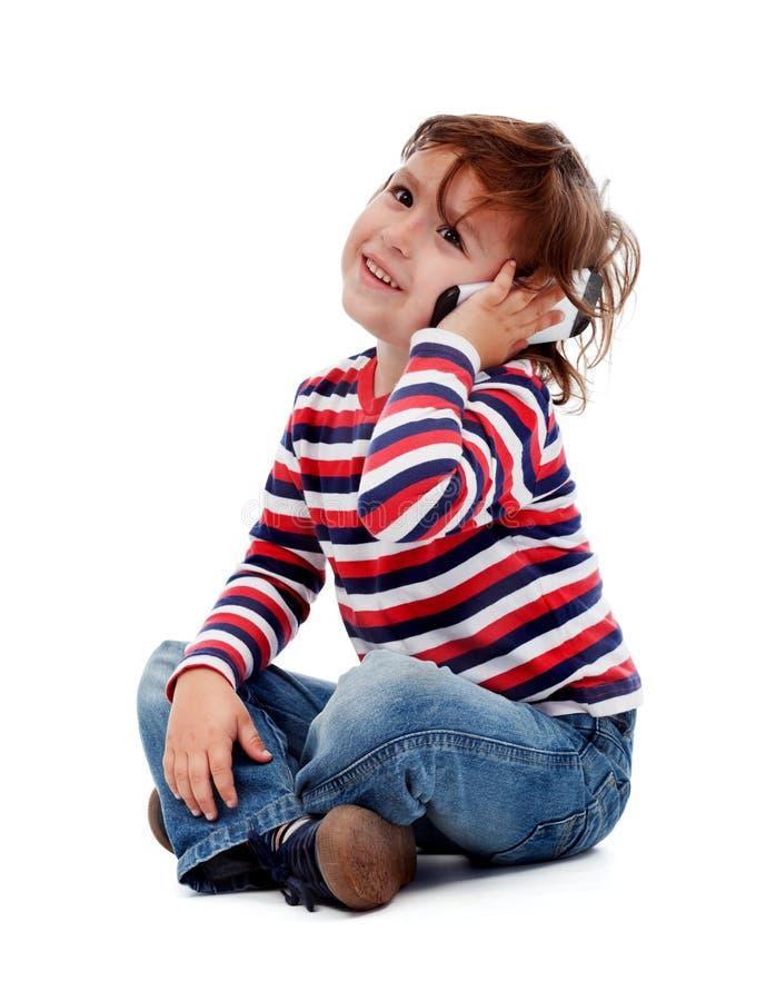 有电话的小男孩 免版税库存图片