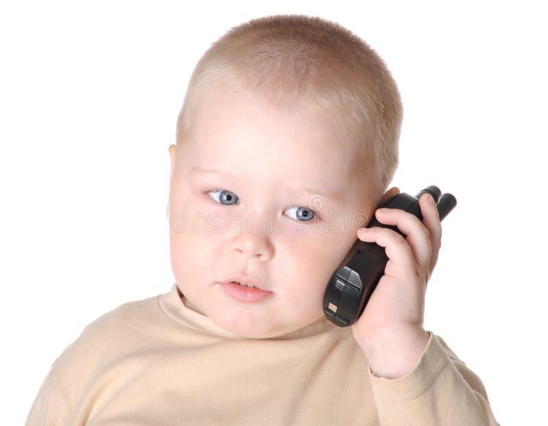 有电话的小的男孩 免版税库存照片