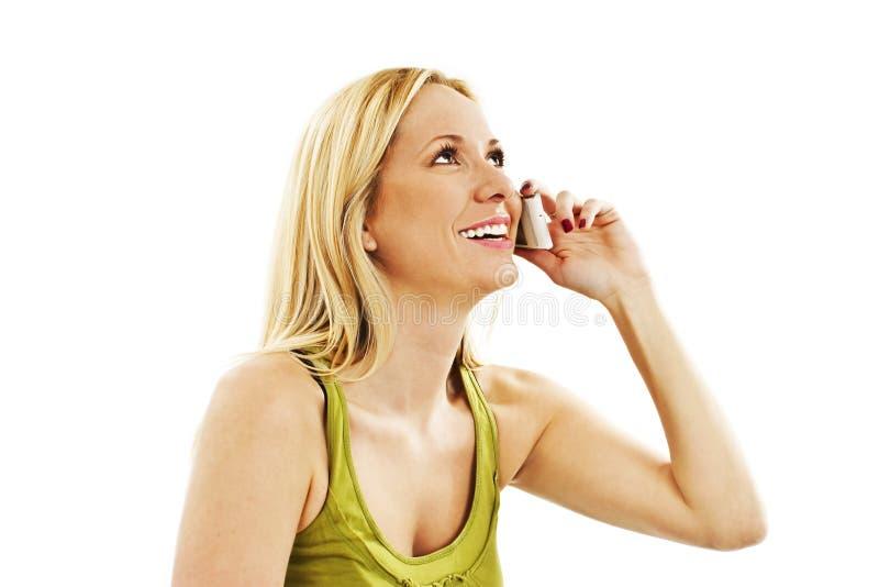 有电话的美丽的年轻白肤金发的妇女 图库摄影