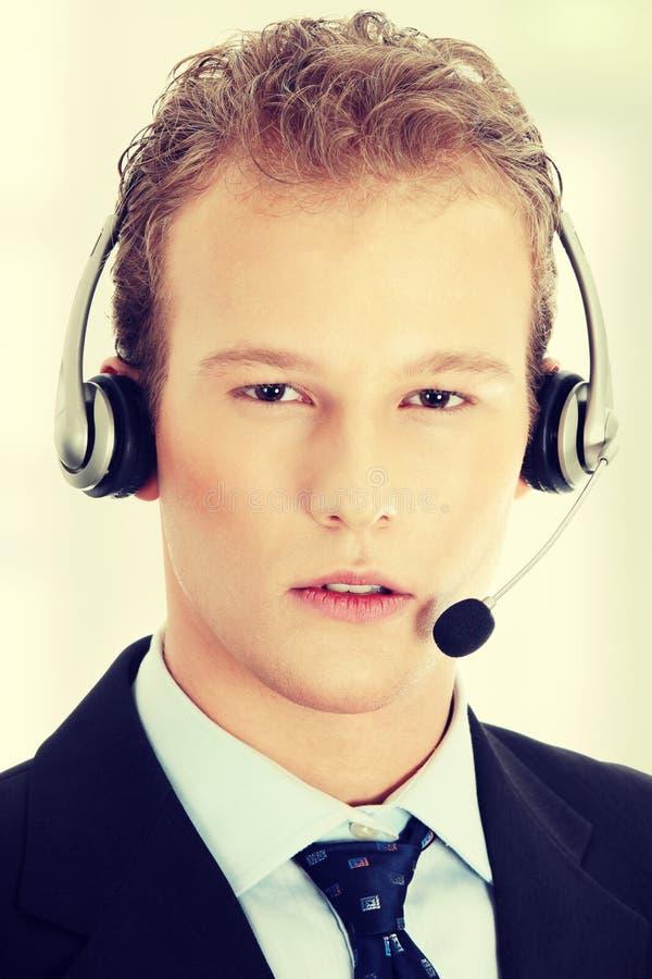 有电话耳机的年轻人 免版税图库摄影