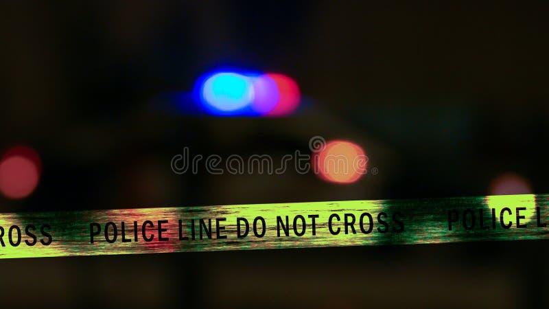 有界限磁带的警车警报器, Defocused 库存图片