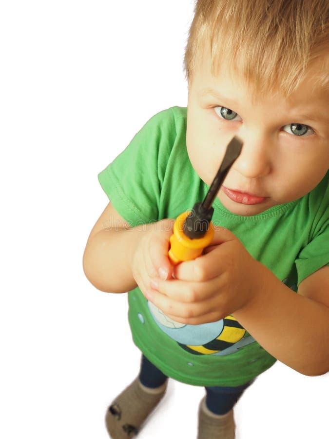 有白发和爸爸` s工具的男孩 免版税库存照片