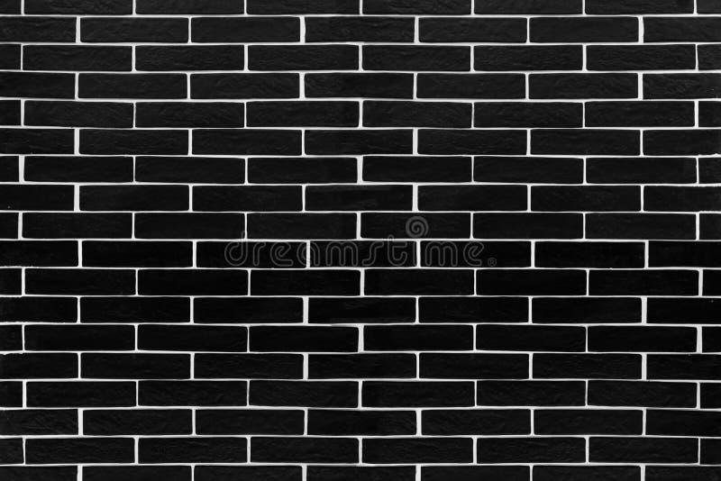有白色不同填水泥的黑砖瓦片 库存照片