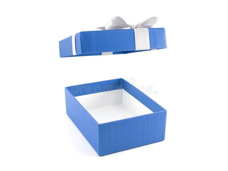 有白色丝带弓的开放和空的蓝色礼物盒 免版税库存图片