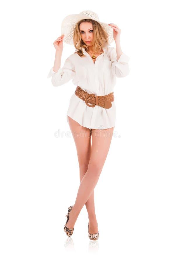 有白色帽子的年轻肉欲的妇女 免版税库存照片