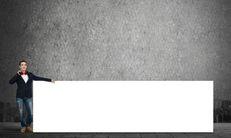 有白色广告牌的人 免版税图库摄影