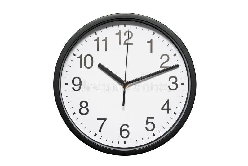 有白色拨号盘的黑办公室壁钟在白色背景 在白色背景隔绝的黑办公室壁钟 图库摄影