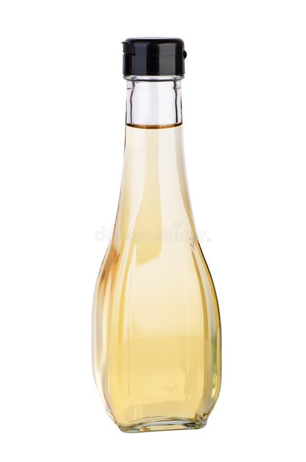有白色芳香抚人的(或苹果)醋的蒸馏瓶 库存照片