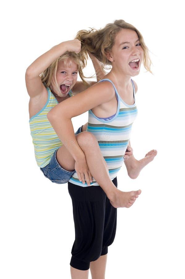 有的乐趣淘气姐妹 免版税库存照片
