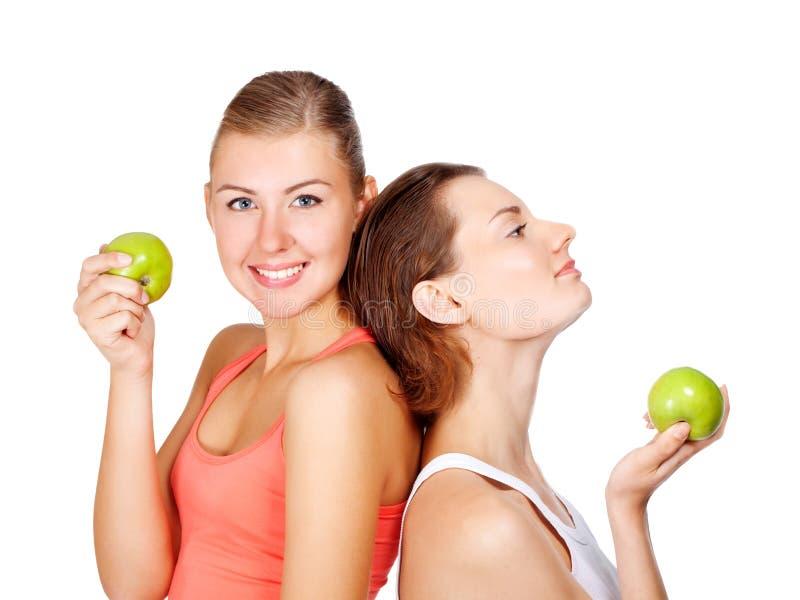 有的二名新美丽的妇女苹果 库存照片