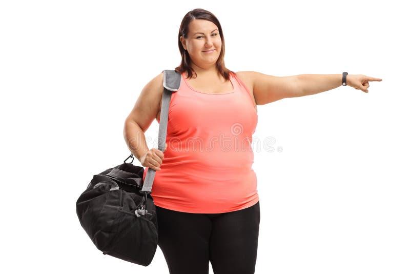 有的超重年轻女人体育请求指向 库存照片