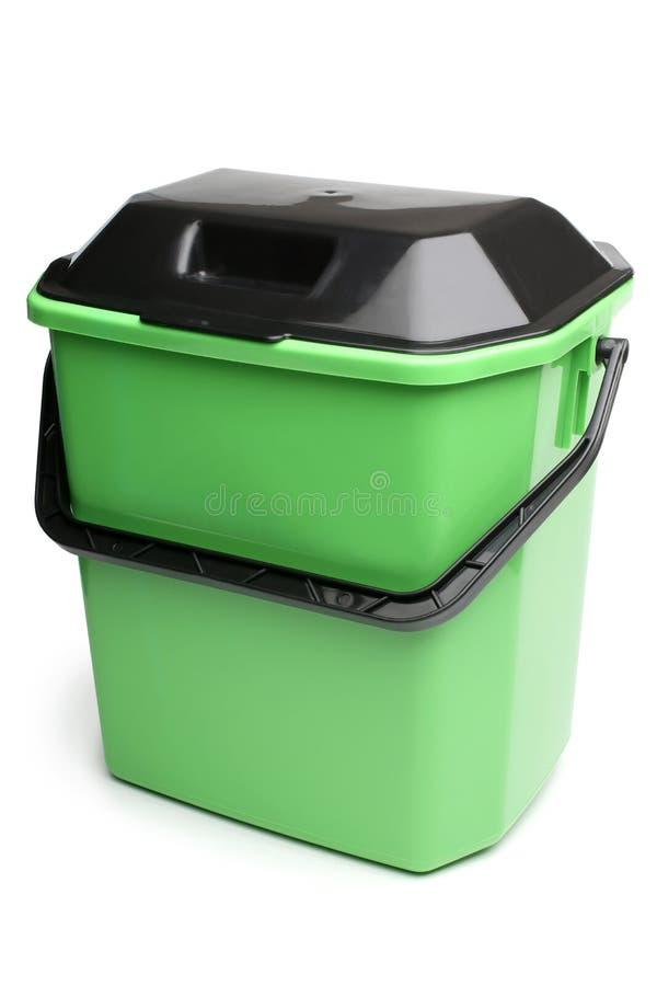 有盒盖的绿色塑料桶 免版税库存图片