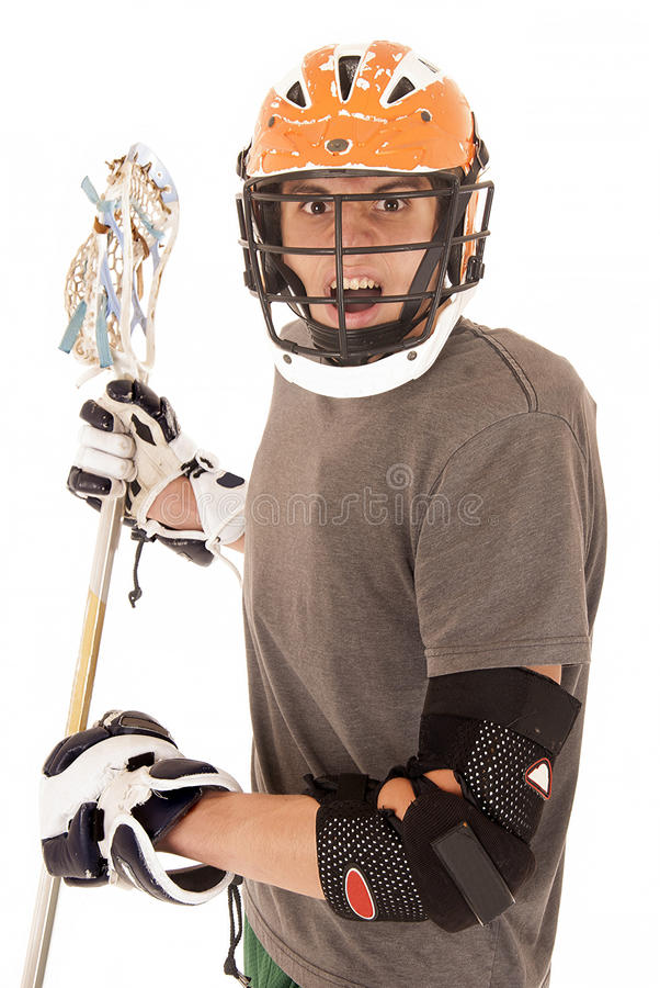 有盔甲和棍子的强烈的男性曲棍网兜球球员 免版税库存图片