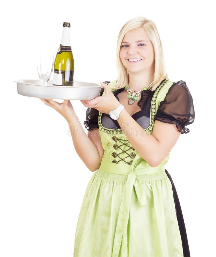 有盘子的年轻女服务员 库存照片