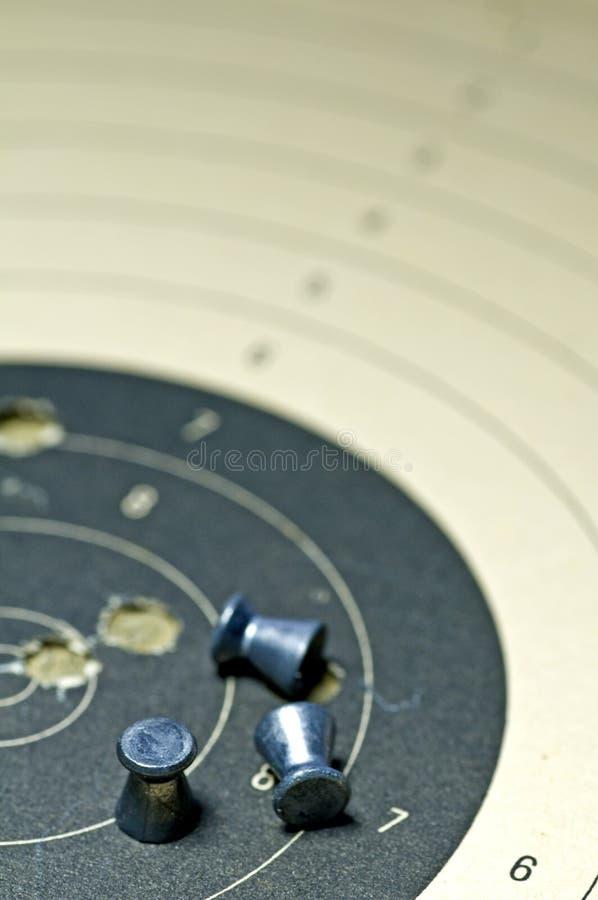 有目标纸张的喷枪弹药 库存照片