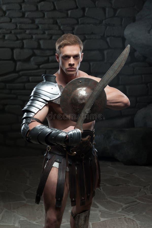 有盾和剑的争论者 免版税库存照片
