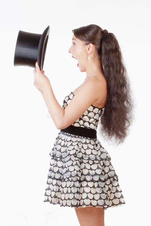 有看起来里面黑帽会议的开放嘴的少妇 免版税库存图片