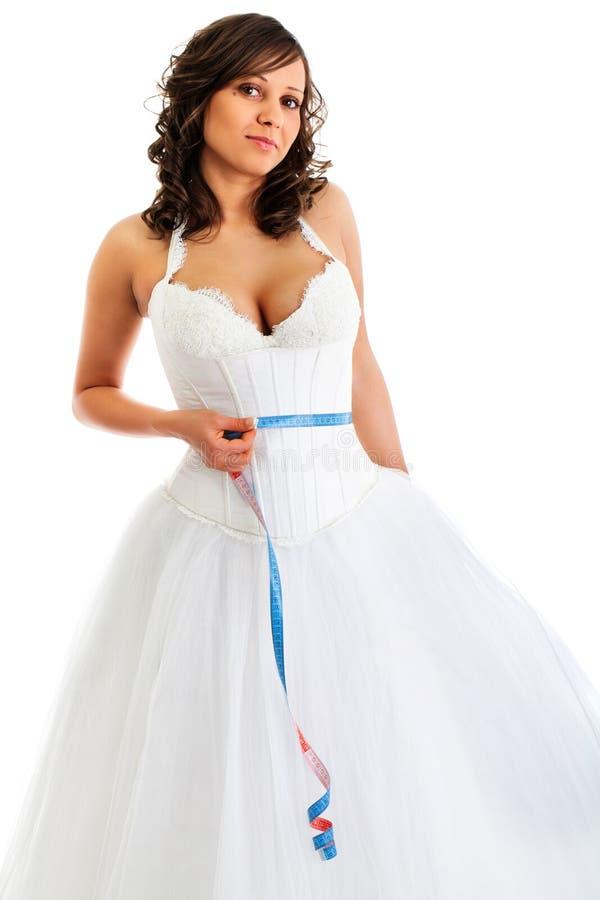 有磁带的年轻新娘在她的腰部附近 免版税库存照片