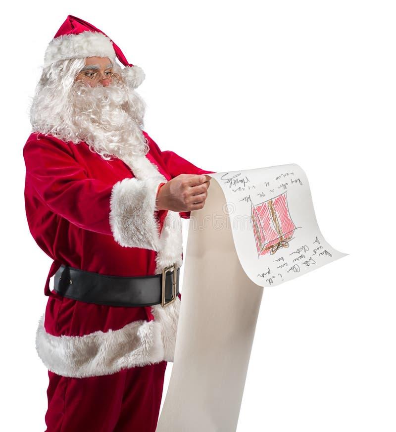有礼品单的圣诞老人 免版税库存照片