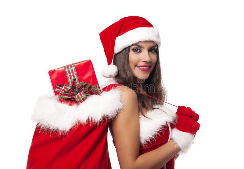 有礼物的圣诞老人女孩 免版税库存照片