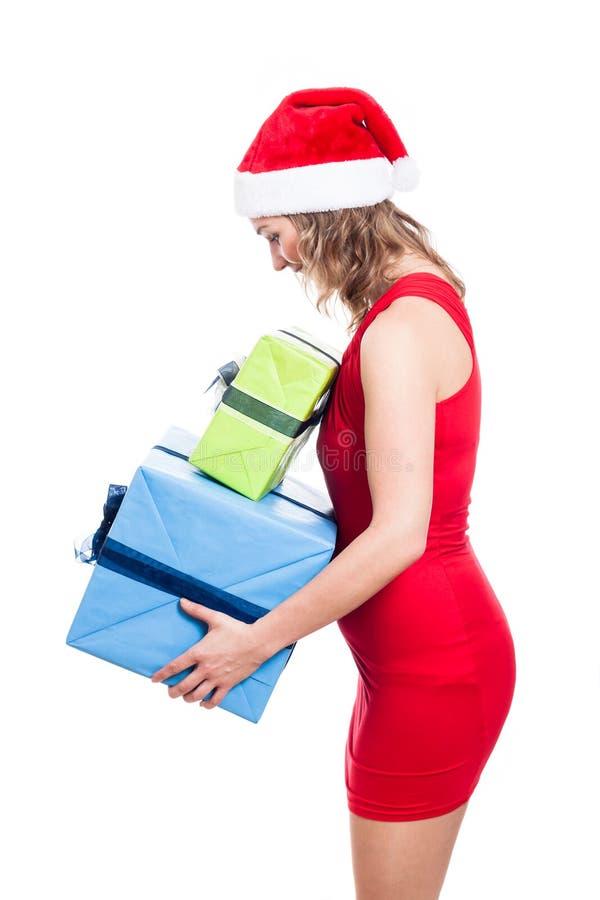 有礼物的圣诞节妇女 库存图片