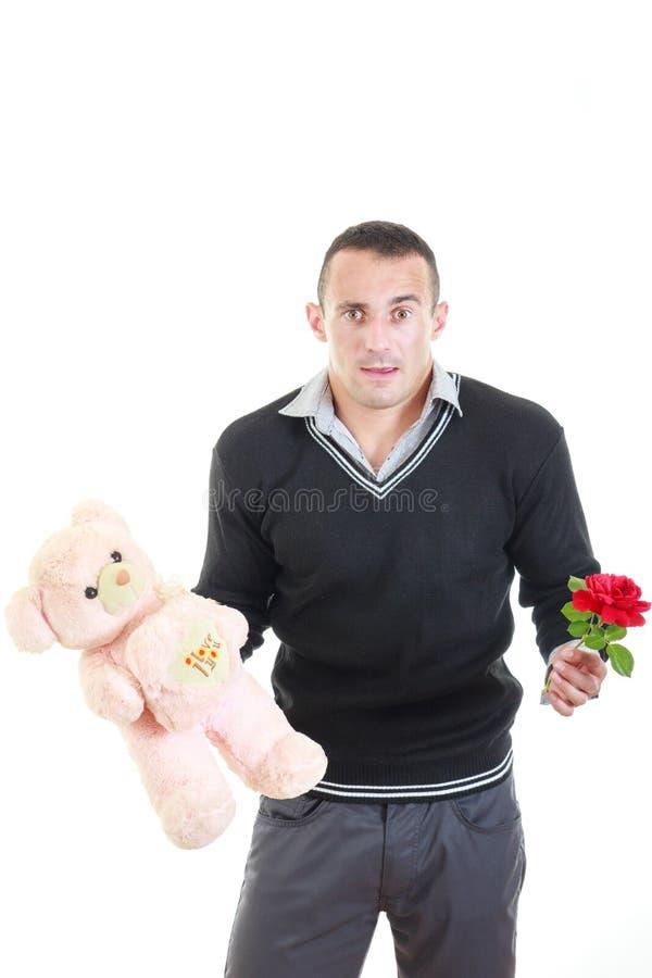 有礼物的浪漫年轻人为情人节 免版税库存照片