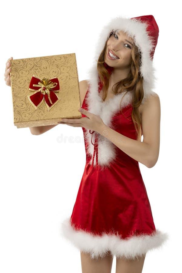 有礼物盒的微笑的圣诞节女孩 免版税库存照片