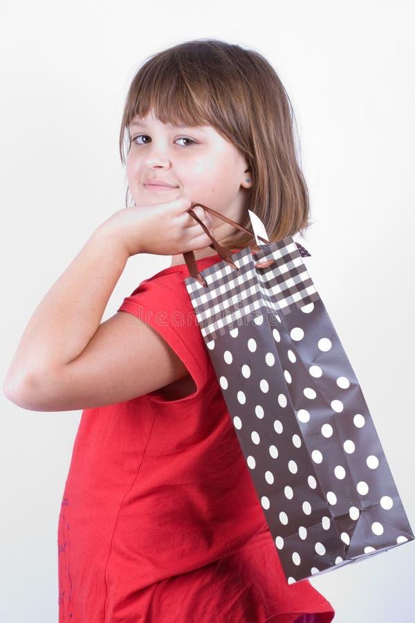 有礼物袋子的女孩 免版税库存图片
