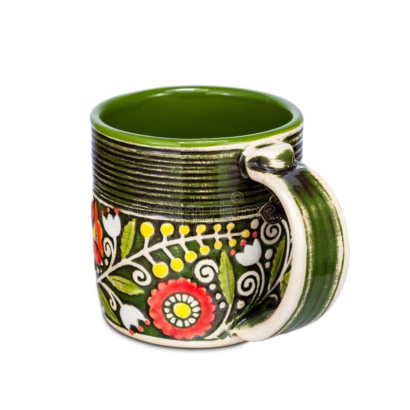 有种族花饰的绿色杯子在白色背景 免版税库存图片