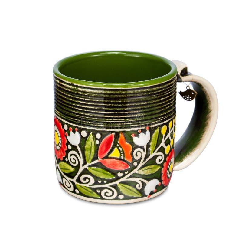 有种族花饰的绿色杯子在白色背景 免版税库存照片