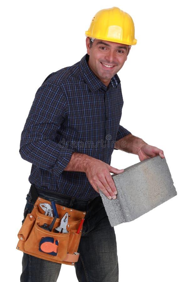 有积木的泥工 免版税库存照片