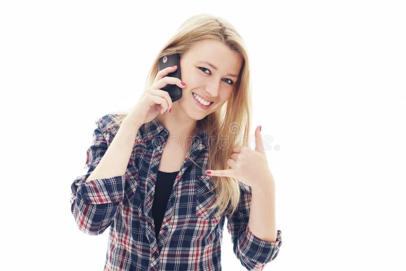 有移动电话的少妇 库存照片