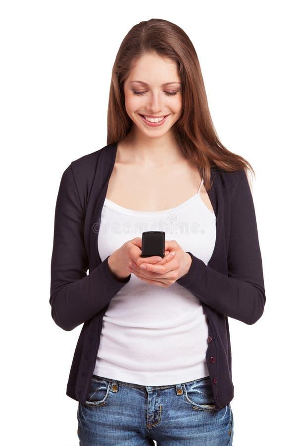 有移动电话的快乐的女孩 库存图片