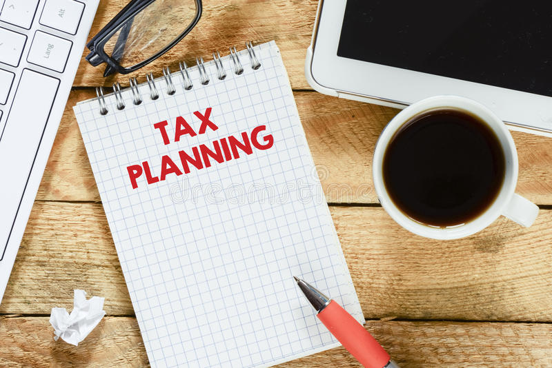 有税务计划的笔记本 免版税库存图片