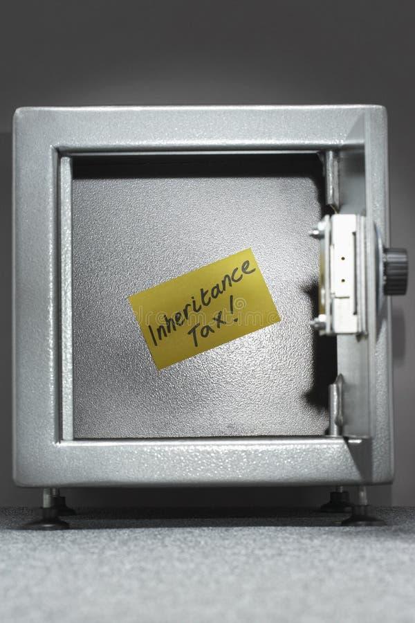 有稠粘的笔记读书的'继承税'保险柜 免版税库存照片