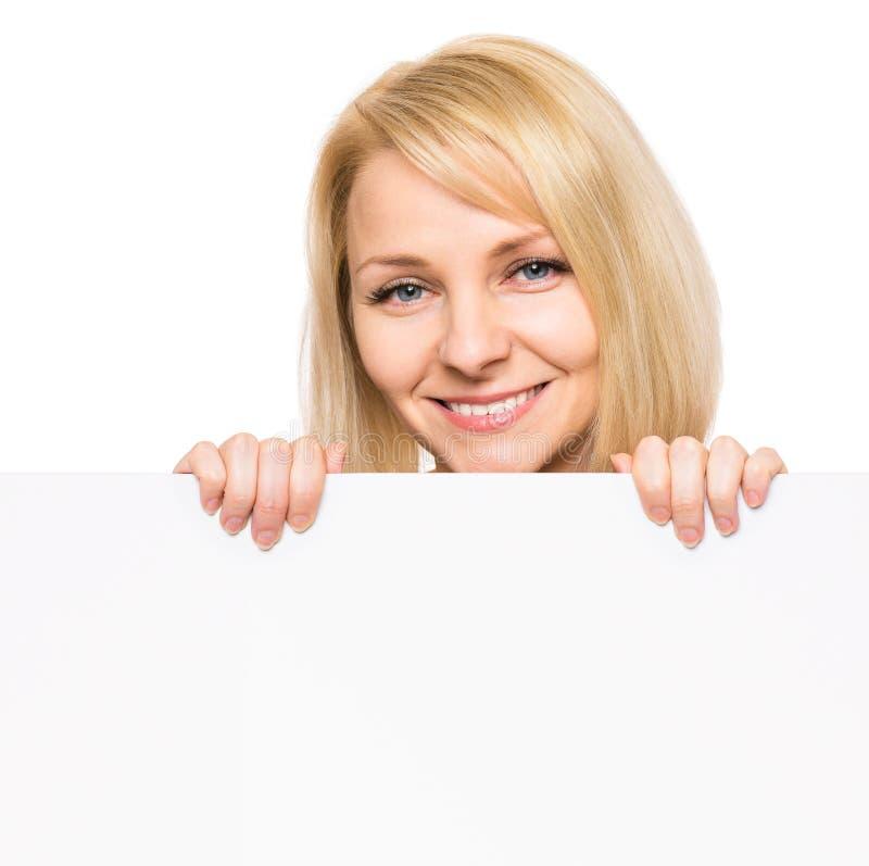 有空白牌的妇女 免版税库存照片