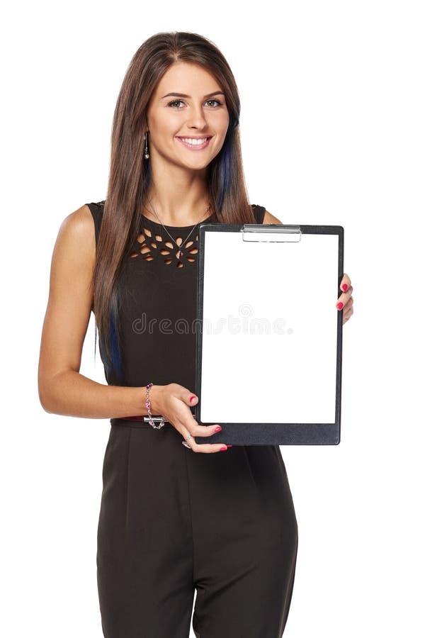 有空白的剪贴板的女商人有copyspace的 免版税库存照片